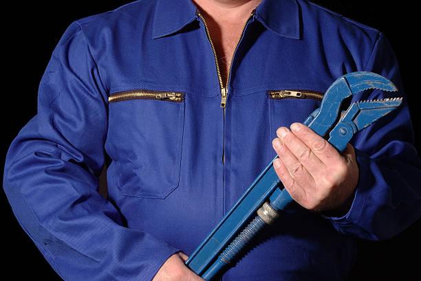 arbeiter - jumpsuit blau stock-fotos und bilder