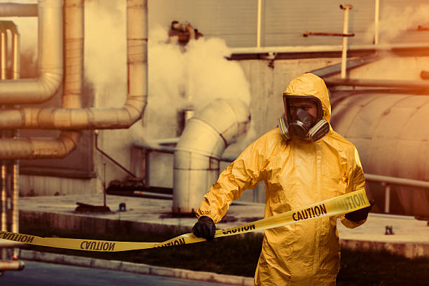 Worker Man in protective workwear with Caution cordon tape decontamination stock pictures, royalty-free photos & images