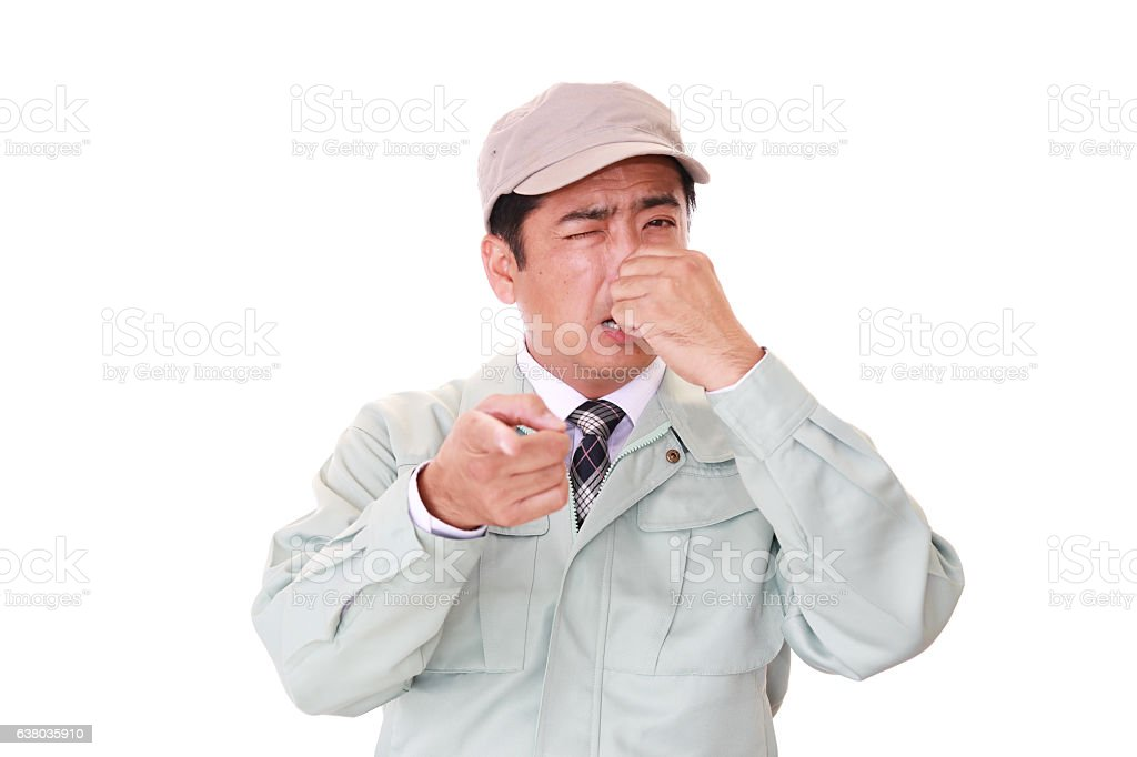Worker pinches his nose stock photo