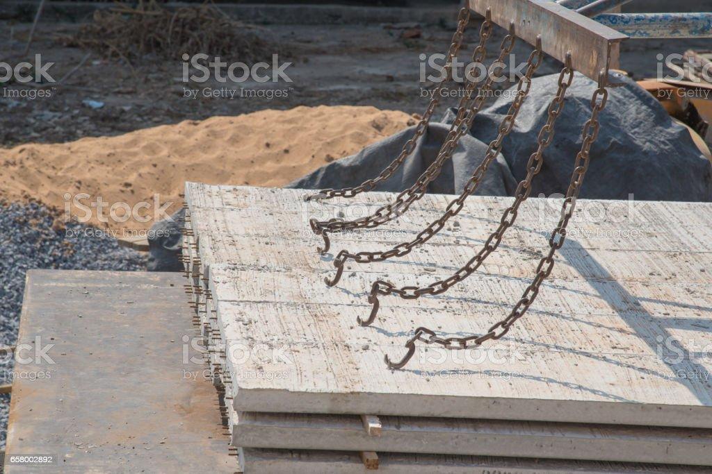 Worker placing cement floor in construction site stock photo