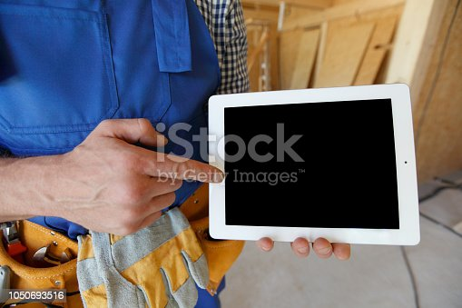 994878714 istock photo Worker pointing at tablet 1050693516