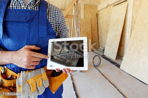994878714 istock photo Worker pointing at tablet 1125403470