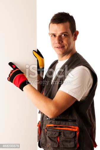 istock Worker points to blank board 453233375