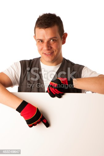 528291188 istock photo Worker points to blank board 453249647