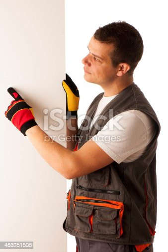 istock Worker points to blank board 453251505