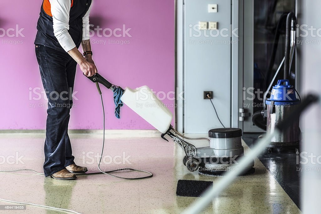Worker Polishing the Floor with Machine stock photo