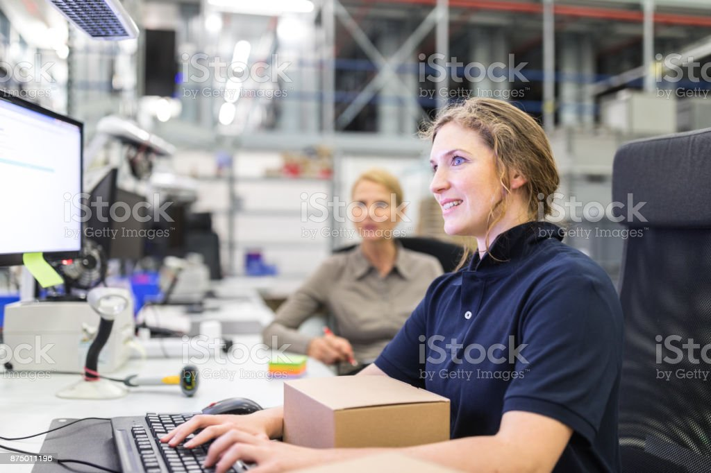 Worker preparing a package to dispatch stock photo