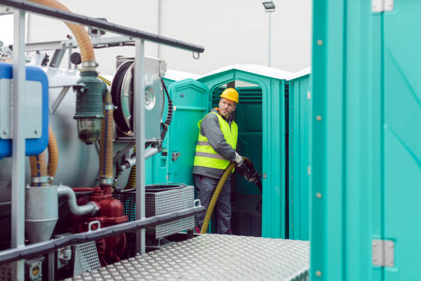 Worker pumping feces out of rental toilet for disposal Worker pumping feces out of rental toilet for disposal and cleaning portable toilet stock pictures, royalty-free photos & images
