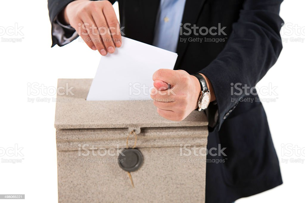 Worker putting letter in mailbox,showing a fig sign stock photo