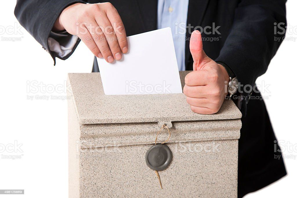 Worker putting letter in mailbox,showing thumbs up gesture stock photo