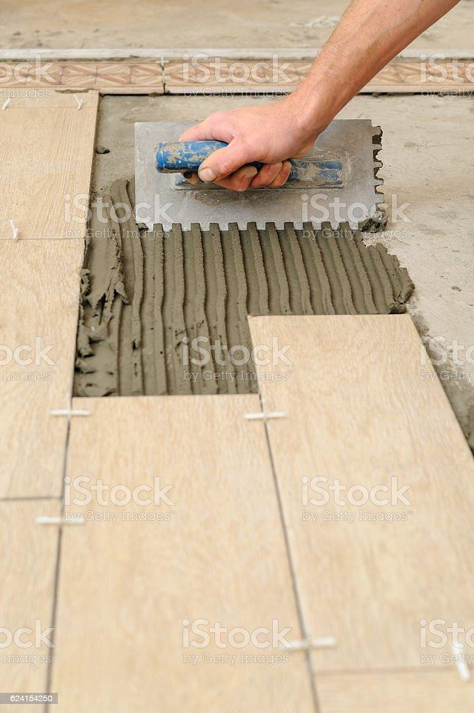 Worker Putting Tiles On The Floor Stock Photo Istock