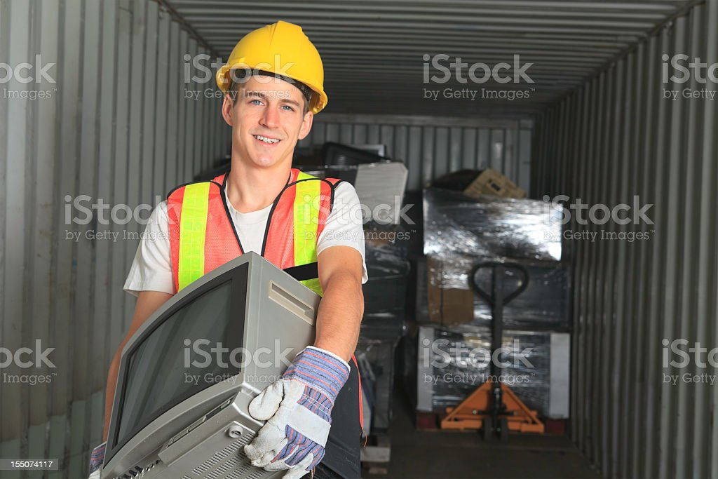 A worker recycling an old television royalty-free stock photo