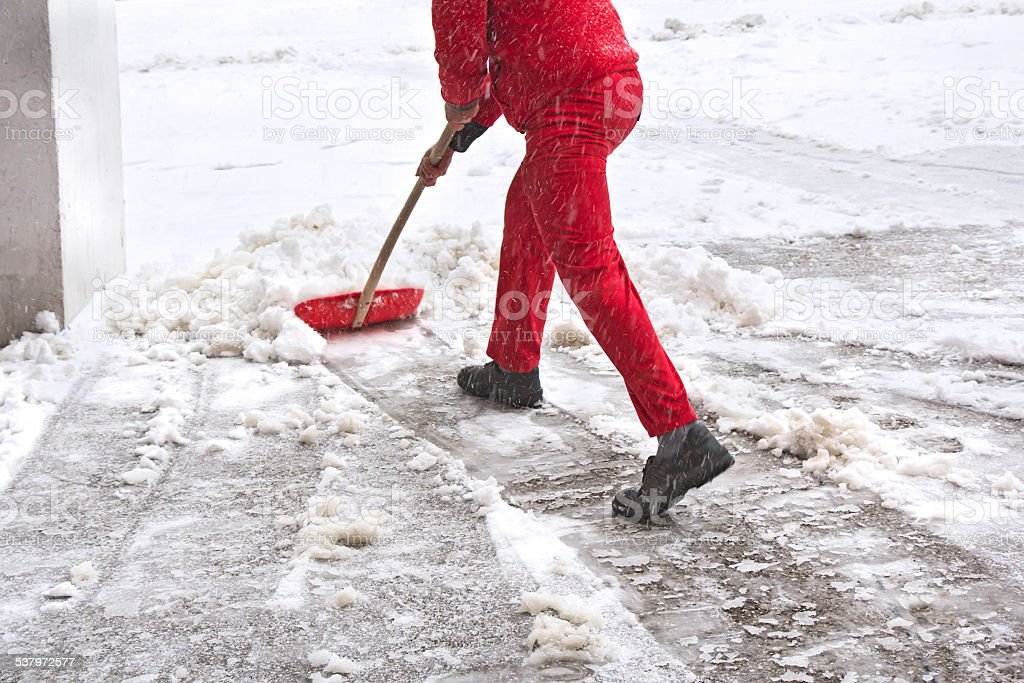 Worker removes snow stock photo