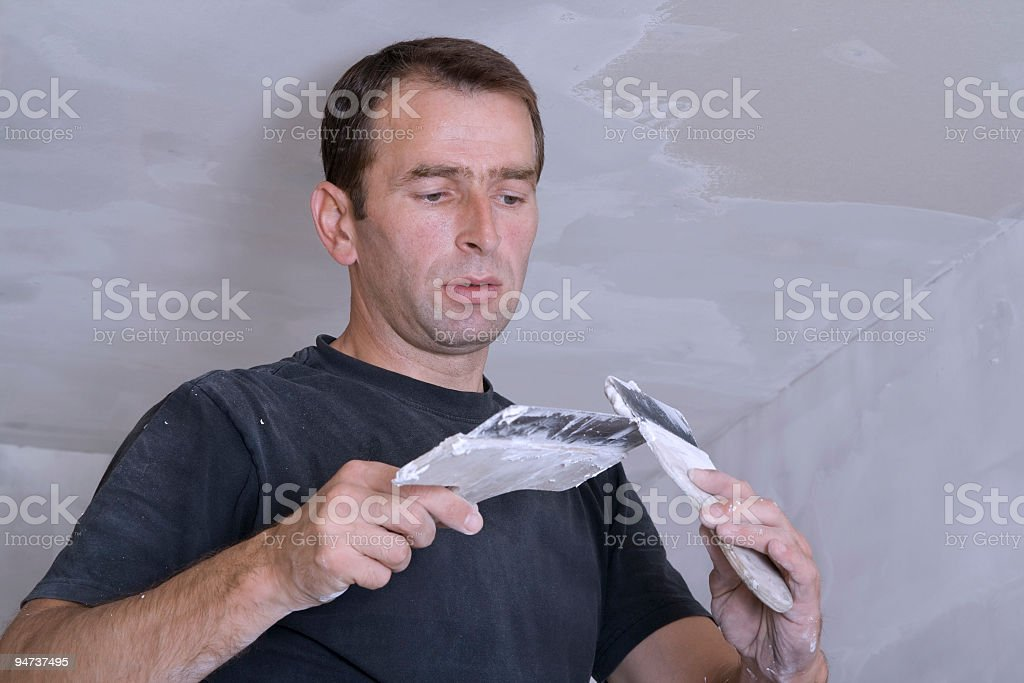 Worker Rendering The Ceiling and Walls royalty-free stock photo