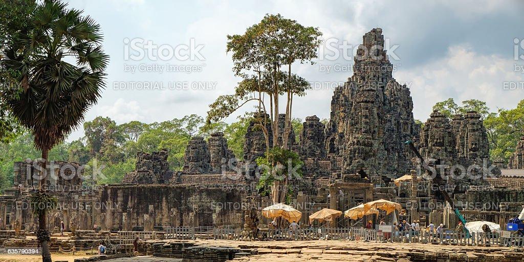 Worker renovate Bayon temple, Cambodia stock photo