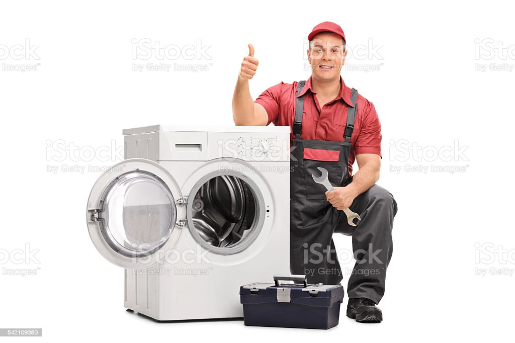 Worker repairing broken washing machine stock photo