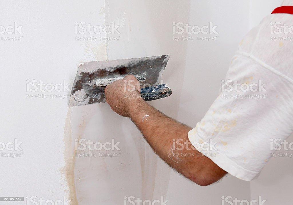 Worker repairing plaster to wall stock photo