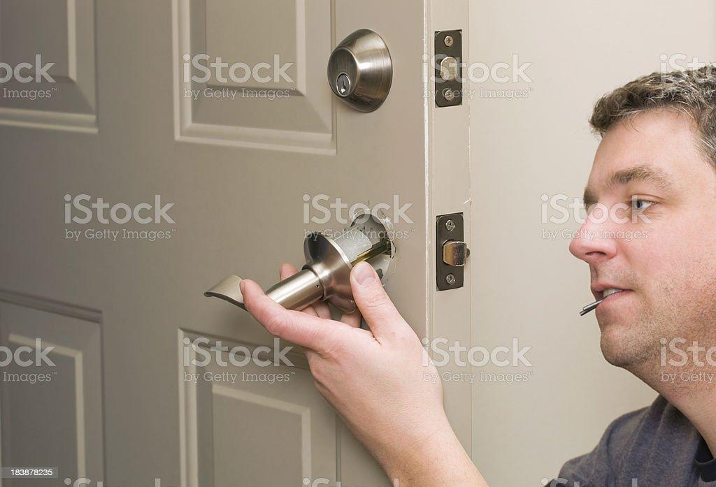 Worker Replacing House Door Latch royalty-free stock photo