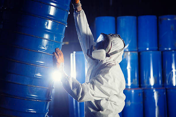 Worker rolling the barrel stock photo