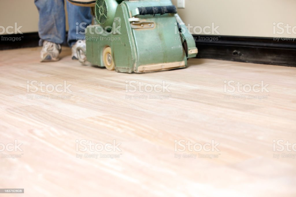 Worker Sanding a New Hardwood Floor stock photo