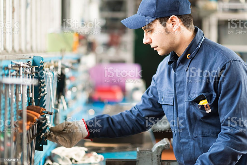 Worker searching for the right tool stock photo