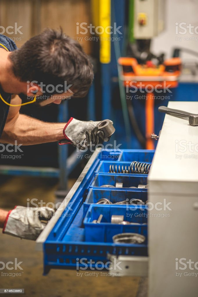 Worker Searching Parts for a Cold Press stock photo