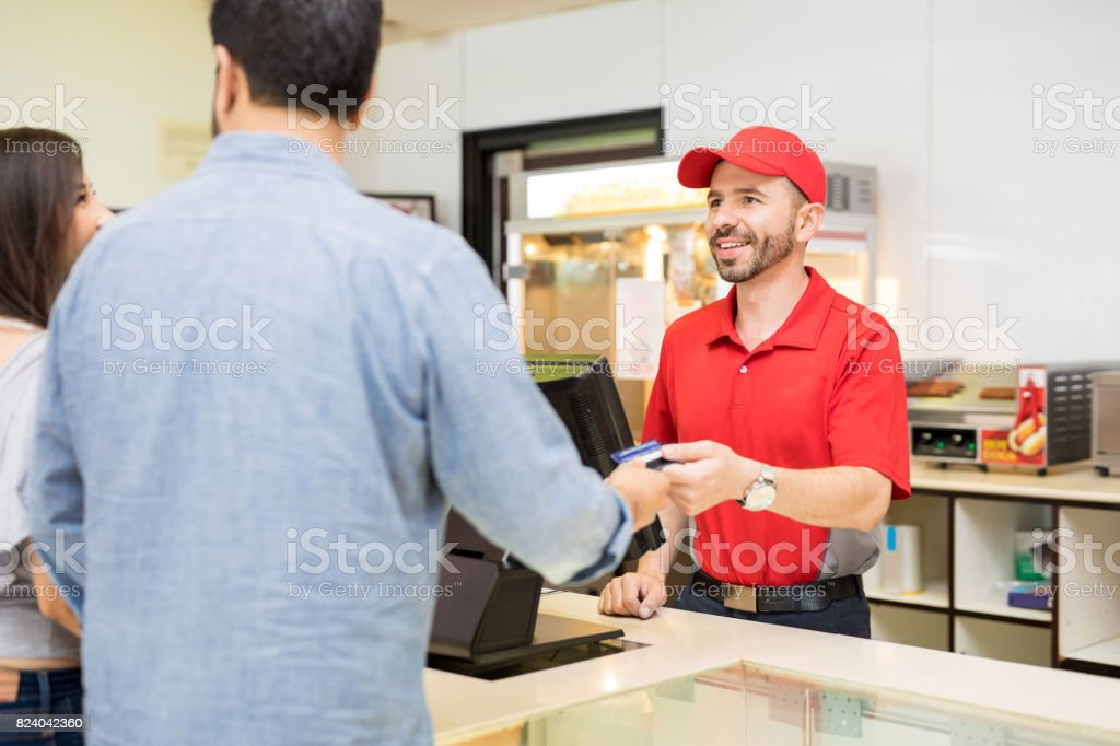 Worker selling some food at the movies stock photo