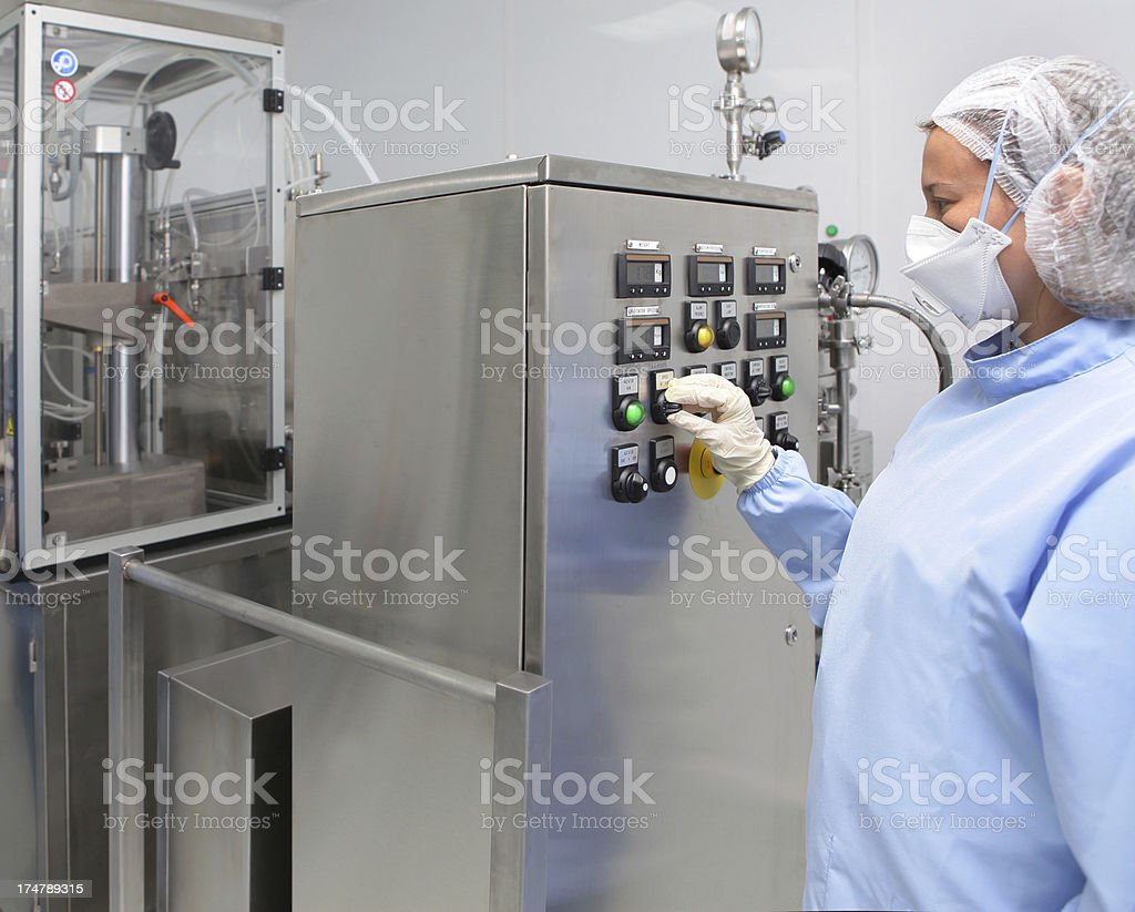 Worker set machine in medicine producing factory royalty-free stock photo