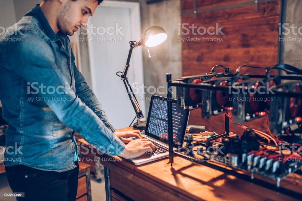 IT worker setting up GPUs for mining cryptocurrency stock photo