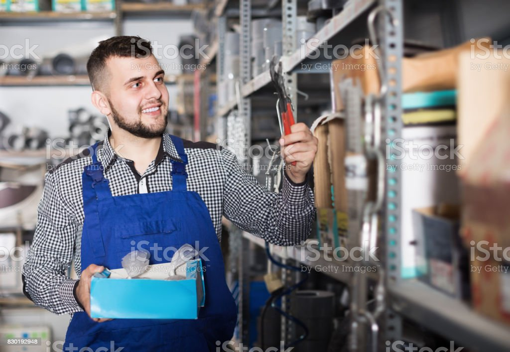 Worker showing his  constructing tools at workplace stock photo