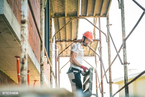Worker Stand On Scaffolding While Building The Foundation