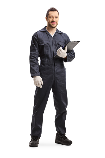 Full length portrait of a worker standing and holding a clipboard isolated on white background