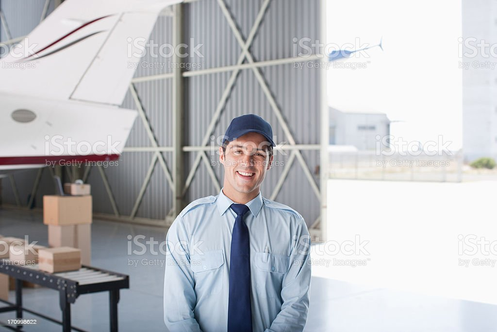 Worker standing in hangar royalty-free stock photo