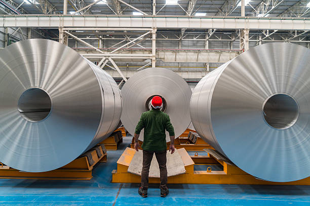 worker standing in the factory - aluminium stock photos and pictures