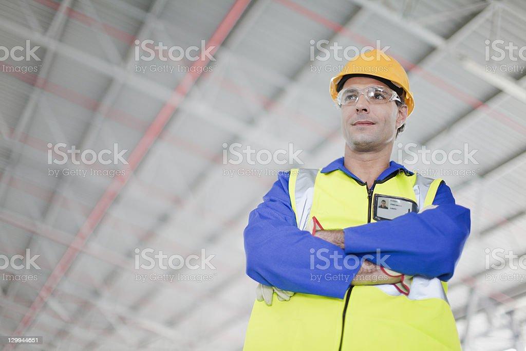 Worker standing in warehouse  40-44 Years Stock Photo