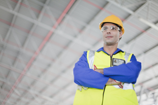 Worker Standing In Warehouse Stock Photo - Download Image Now