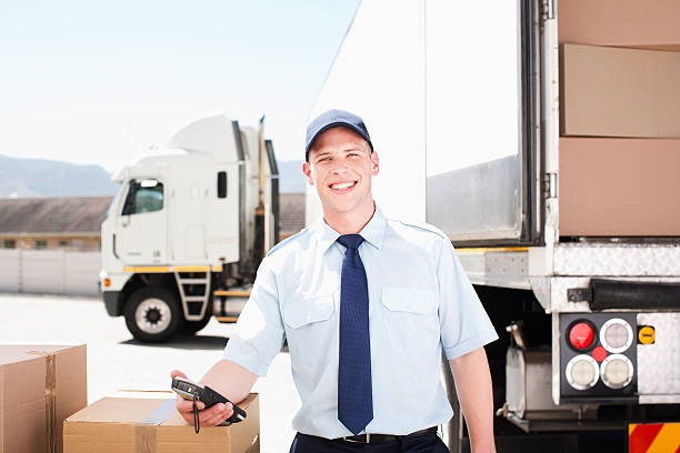 worker standing with boxes near semi-truck - lorries unloading stock photos and pictures