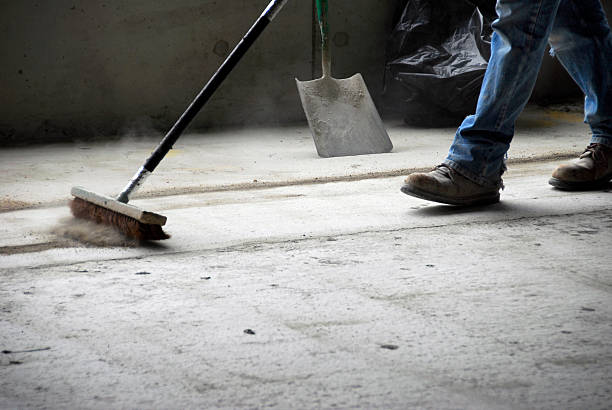 worker sweeping up at construction site - sweeping stock pictures, royalty-free photos & images