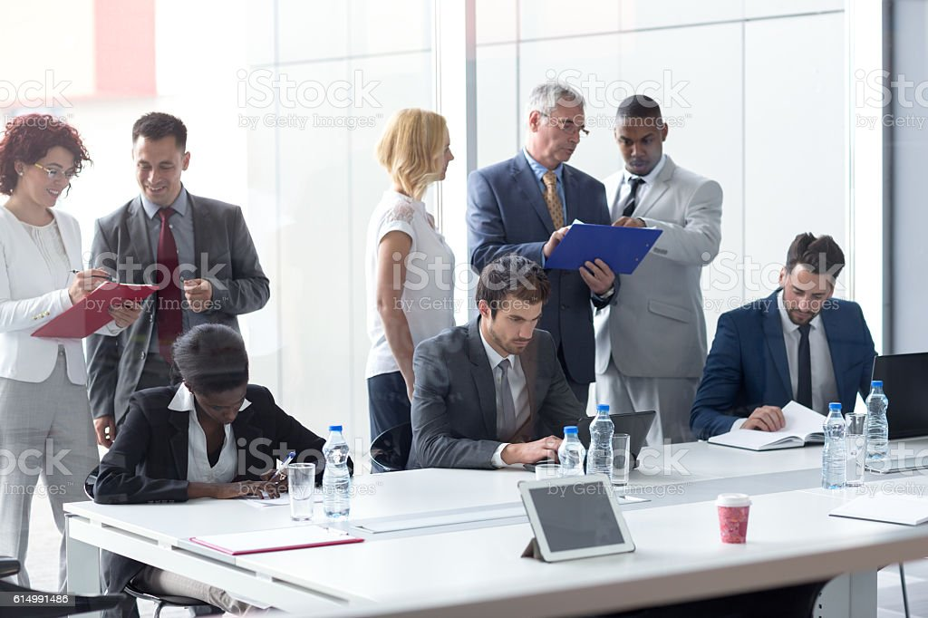 Worker team at meeting in company analyzing management stock photo