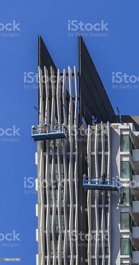 Worker Team Working on Facade of High Building royalty-free stock photo