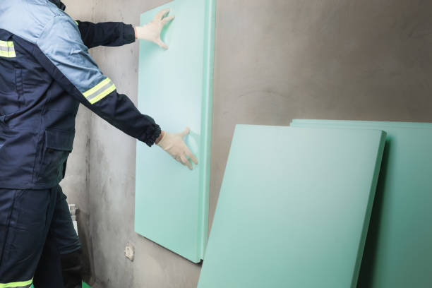 Worker to glue insulation from polyurethane stock photo
