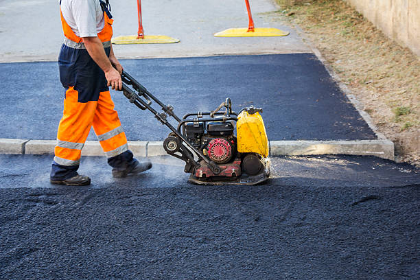 Worker use vibratory plate compactor Worker use vibratory plate compactor compacting asphalt at road repair compactor stock pictures, royalty-free photos & images