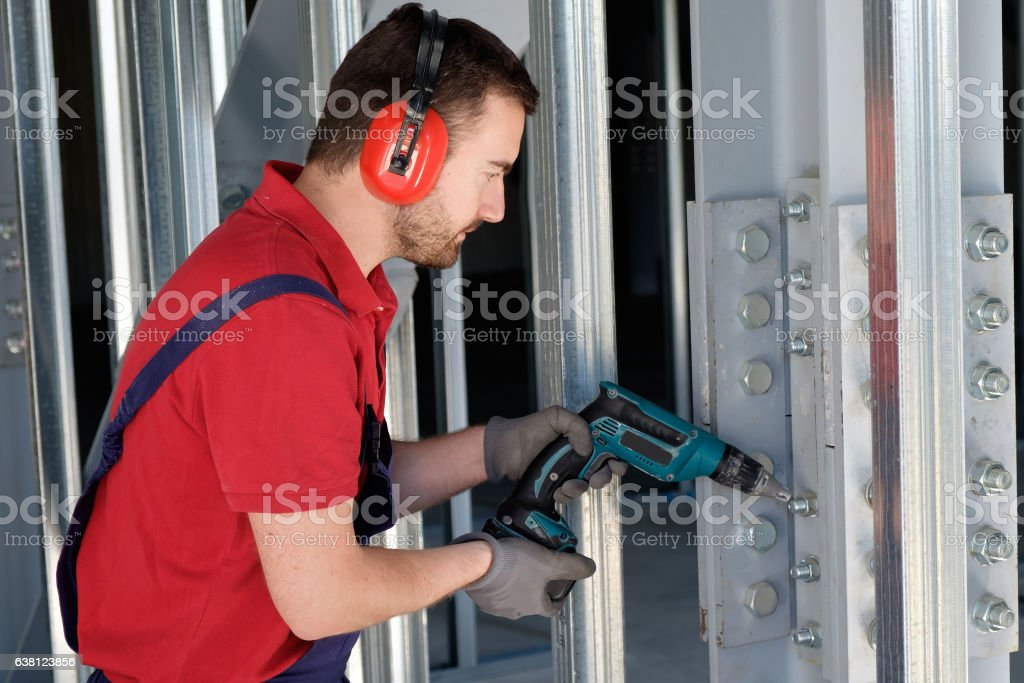 Worker using a drill stock photo