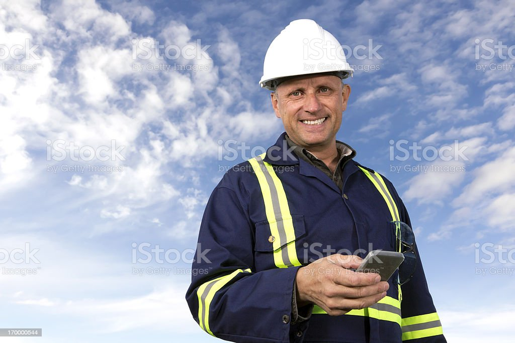 Worker Using a Smartphone royalty-free stock photo