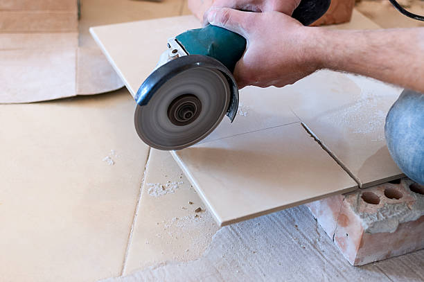 Royalty Free Cutting Tile With Grinder Pictures Images And Stock
