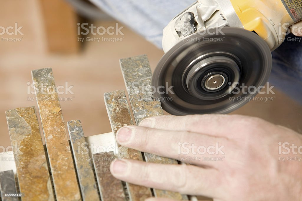 Worker Using An Angle Grinder To Trim Stone Backsplash Tile Stock Photo Download Image Now Istock