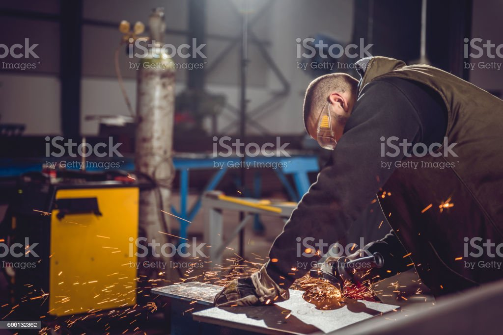 Worker Using Angle Grinder stock photo