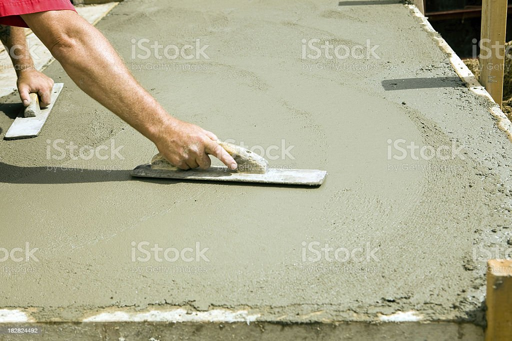 Worker Using Concrete Trowel to Smooth Entrance Step stock photo