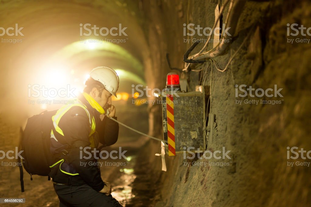 Worker using emergency phone stock photo