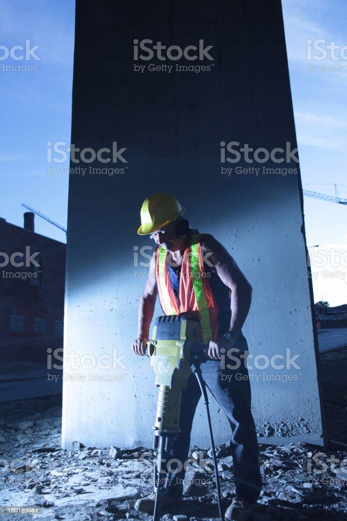 worker using jackhammer stock photo